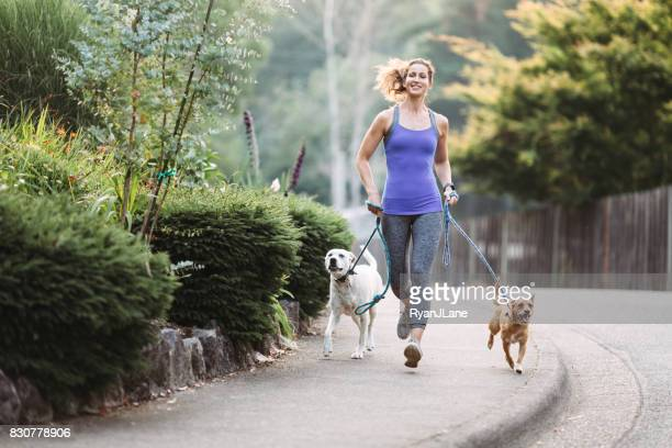 Woman Jogging With Dogs