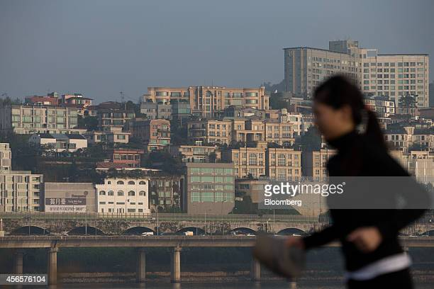 A woman jogs along the Han River past UN village in Seoul South Korea on Tuesday Sept 30 2014 South Korean President Park Geun Hyes success in...