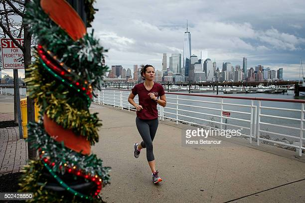 A woman jogs along the Hudson River shore on December 24 2015 in Newport New Jersey New York and New Jersey have seen highs in the upper 50s this...