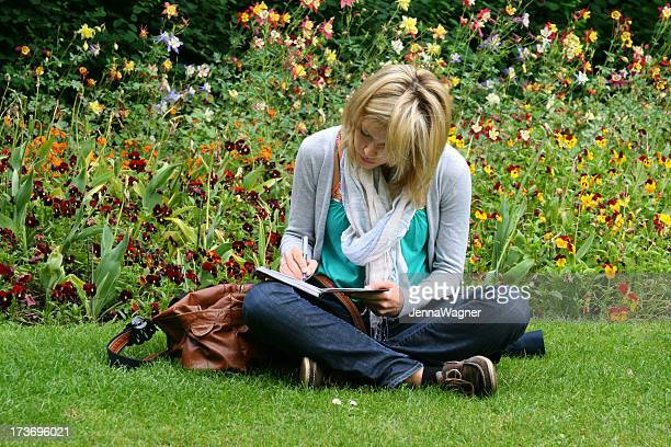 A woman journaling in the park