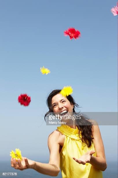 Woman juggling flowers