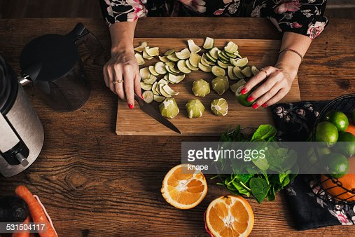 Woman juicing with fresh fruit