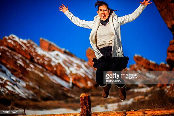 Woman jumping a fence in Red rocks national park
