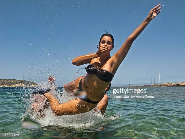 Woman jumping at sea