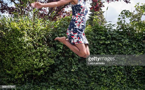 Woman jumping high