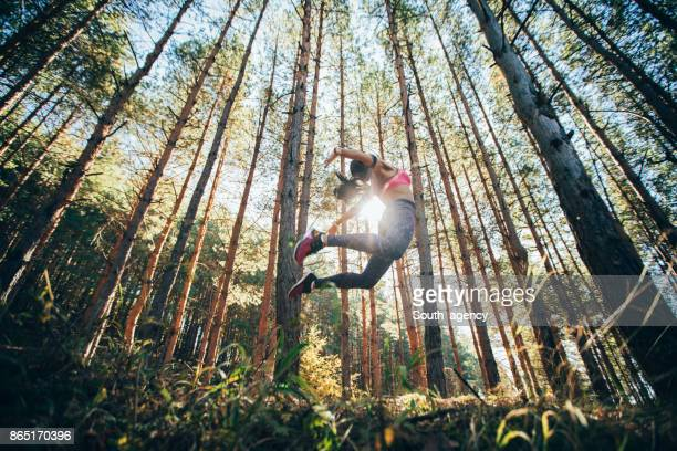 Woman jumping in a forest