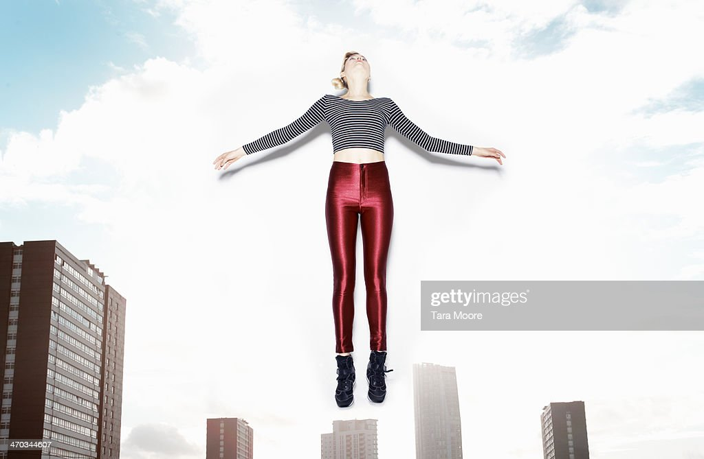 woman jumping in city