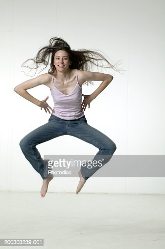 Woman jumping in studio : Stock Photo
