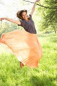 Woman Jumping In Summer Field
