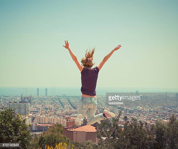 Woman jumping in the air, Barcelona, Spain