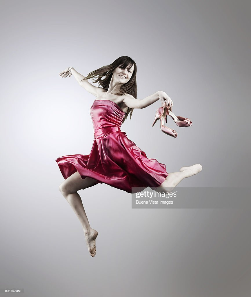 Woman jumping in the air : Stock Photo