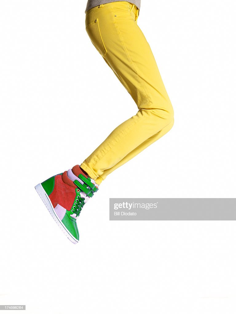 Woman jumping in wedge sneakers