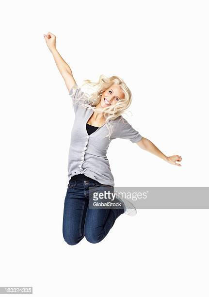 A woman jumping into the air with her hands up