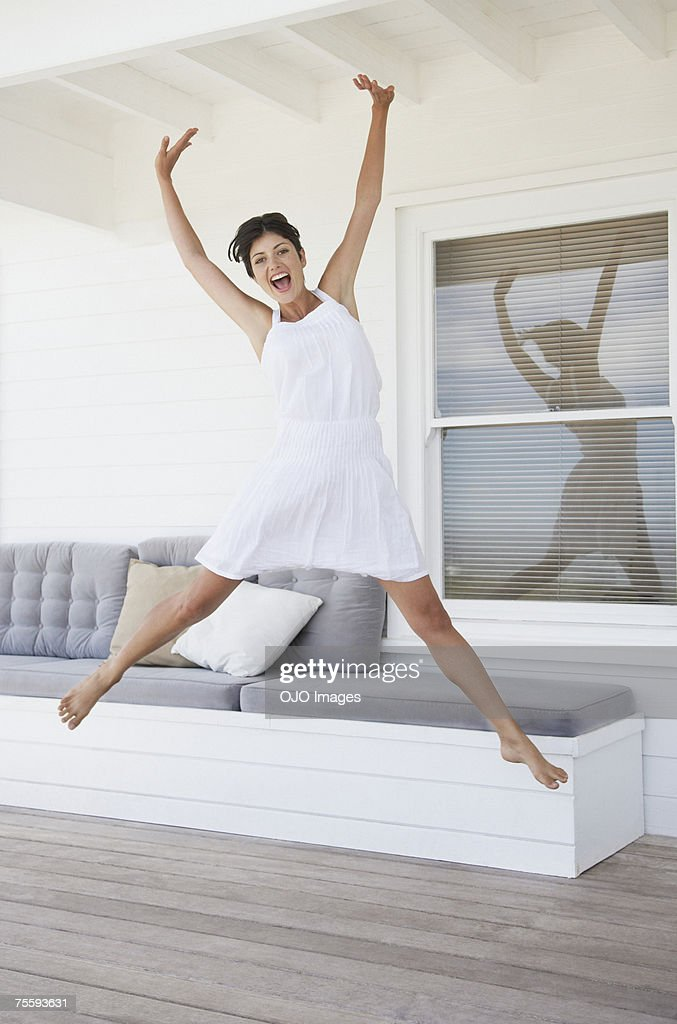 Woman jumping on a terrace : Stock Photo