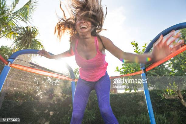 Woman jumping on a trampolin