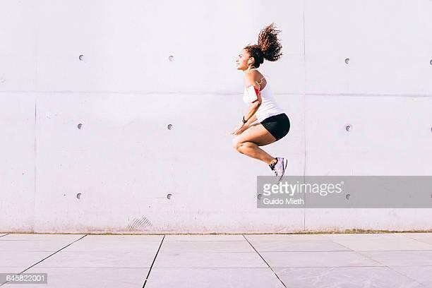 Woman jumping.