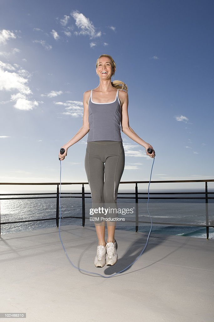 Woman jumping rope : Stock Photo