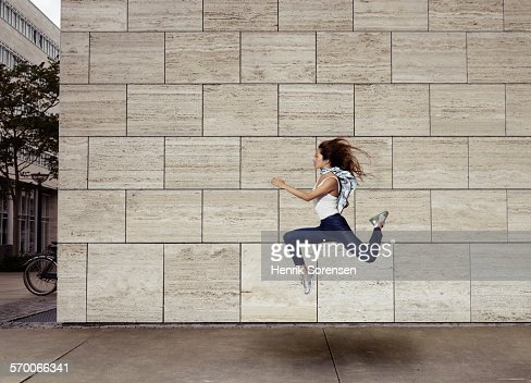 Woman jumping sideways
