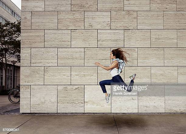 Woman jumping sideways