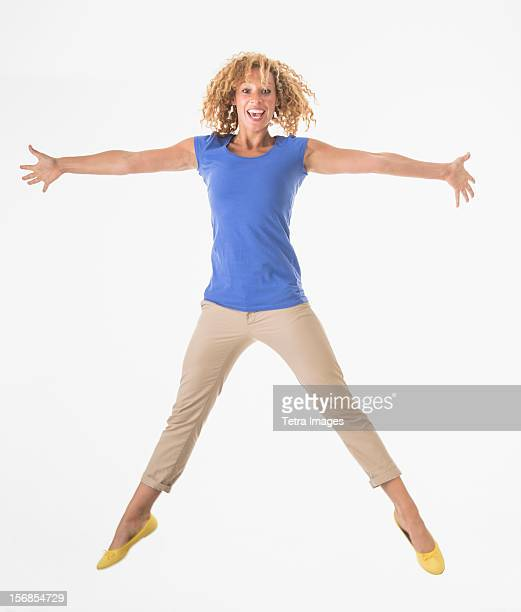 Woman jumping, studio shot