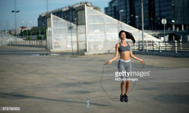 Woman jumping the rope