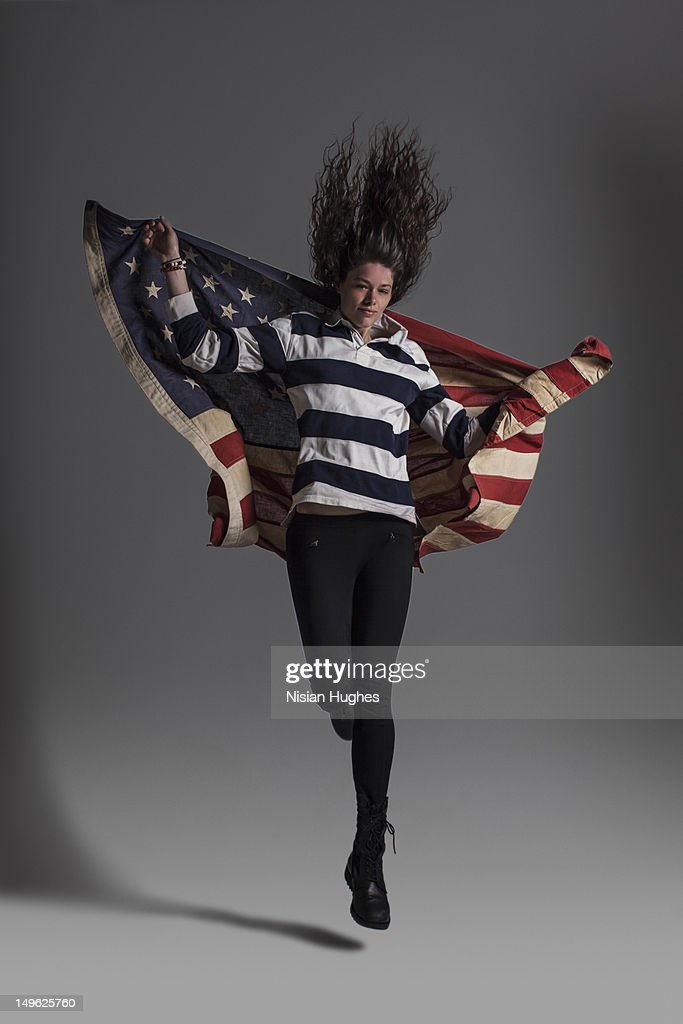 woman jumping with American flag : Stock Photo