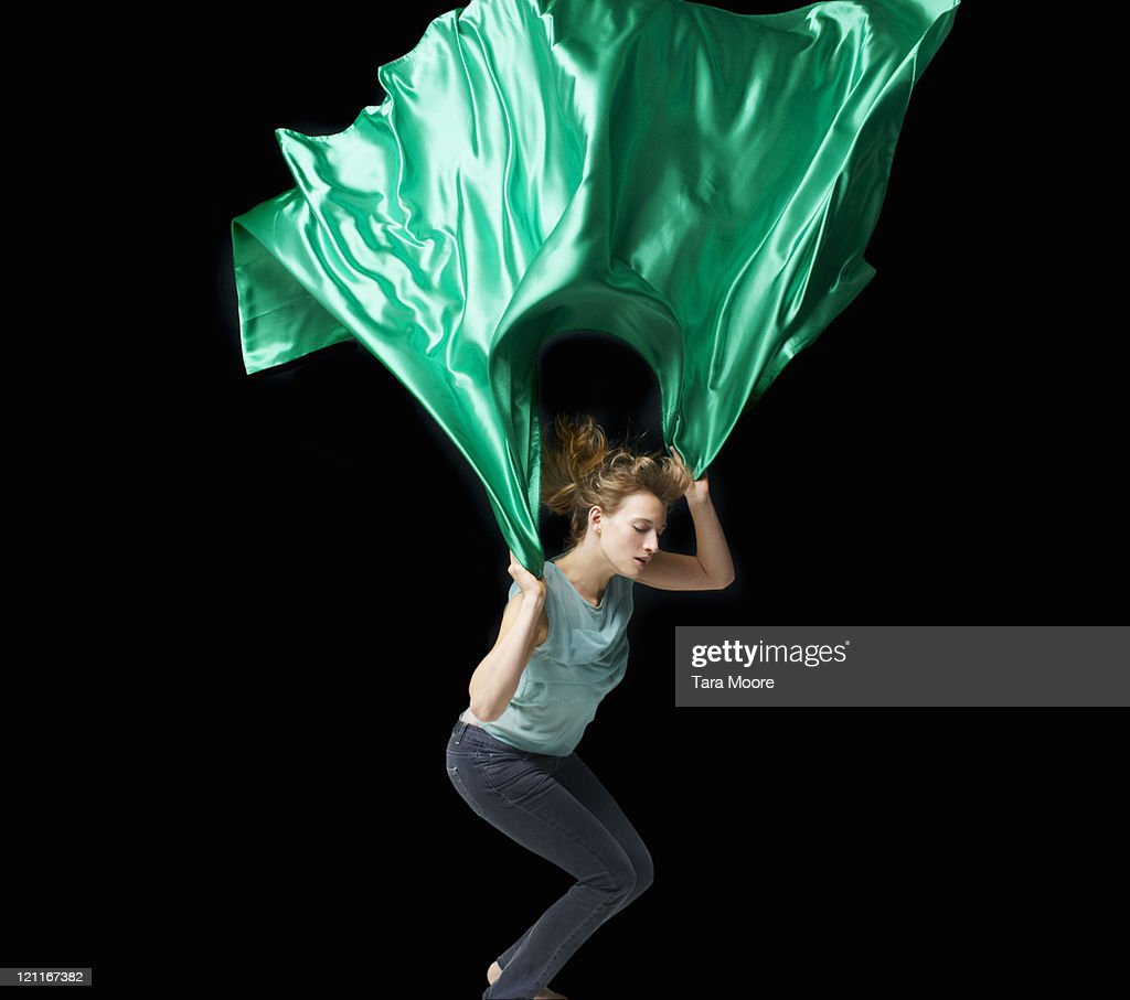 woman jumping with green material : Stock Photo