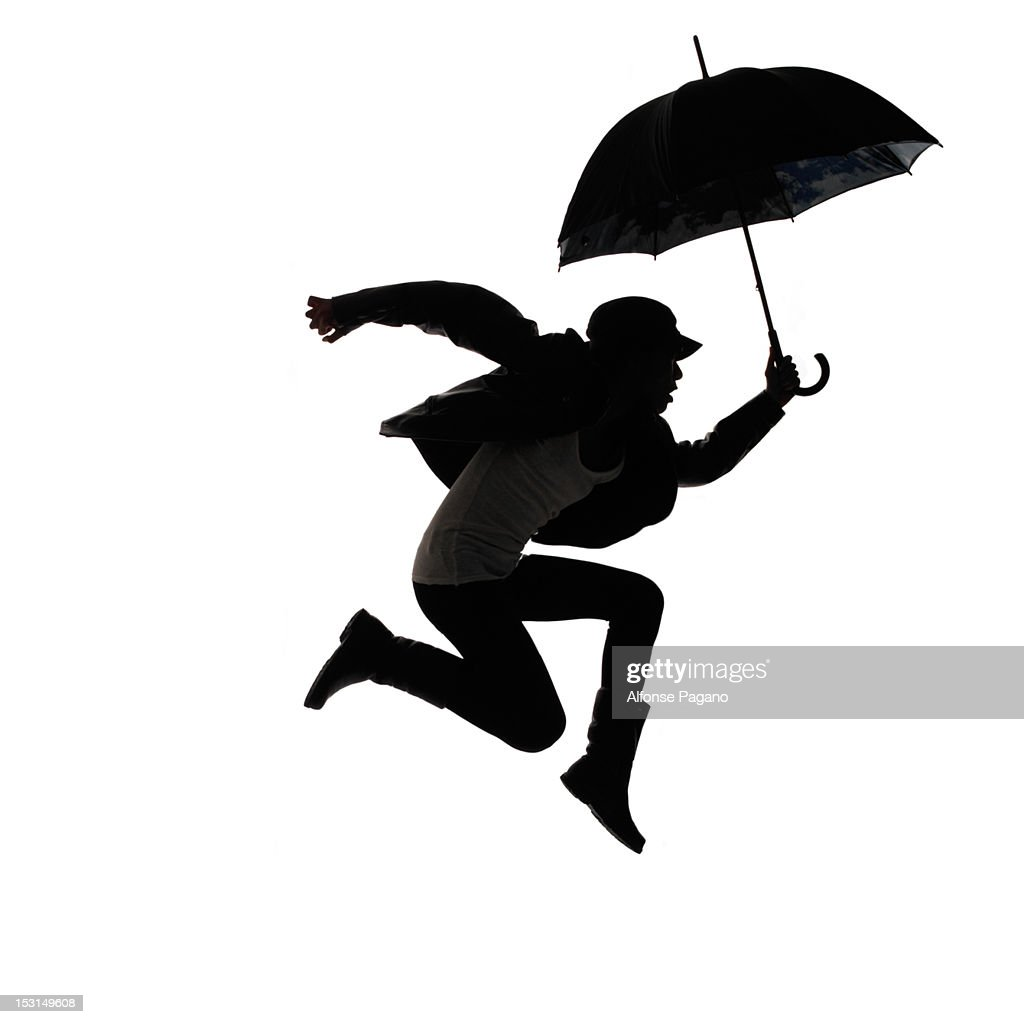 woman jumping with umbrella : Stock Photo