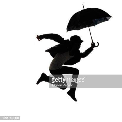 woman jumping with umbrella : Stockfoto
