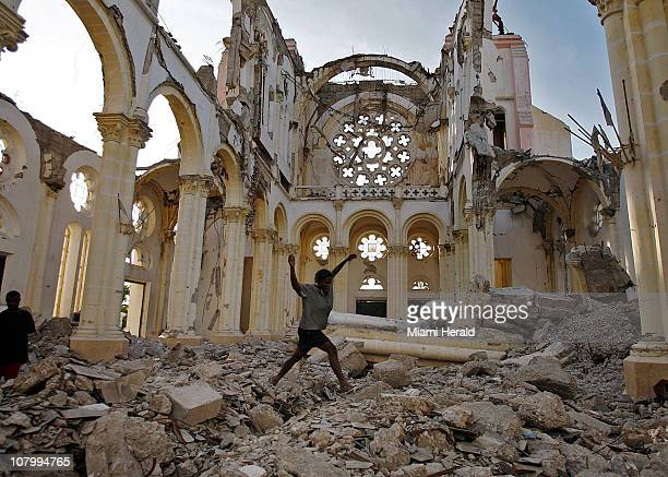 A woman jumps across the debris inside the National Cathedral in PortauPrince Haiti searching for anything of value January 7 2011 Many of the...