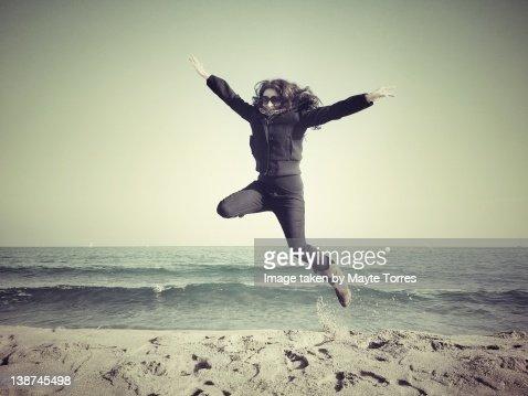 Woman Jumps in beach daylight