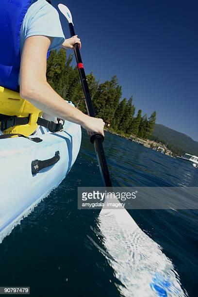 woman kayaker paddling
