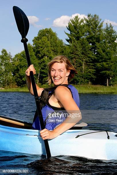 Woman kayaking and laughing