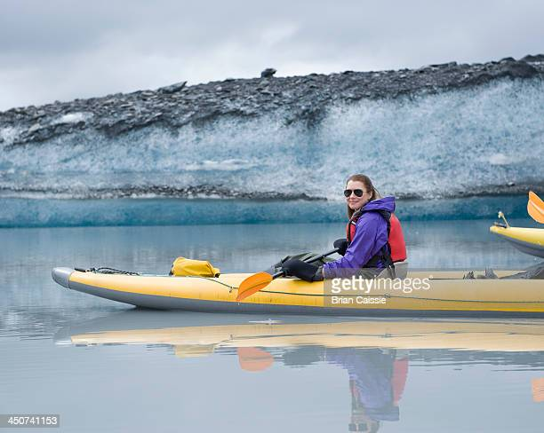 Woman kayaking at Valdez Glacier, Alaska, USA