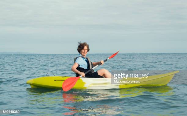 Woman kayaking on calm seas