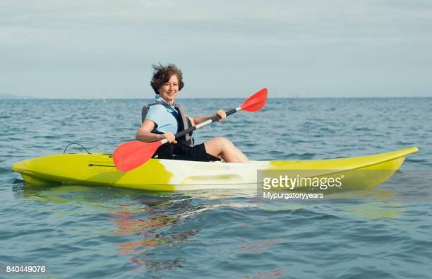 Woman kayaking on the sea