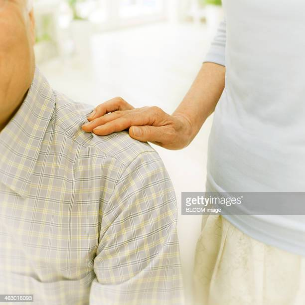 Woman Keeping Hand On Man's Shoulder