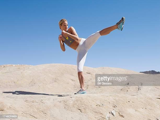 woman kicking in the desert