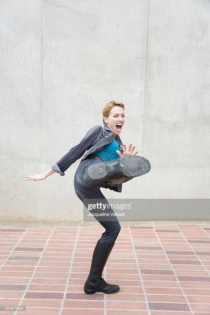 Woman kicking  : Stock Photo