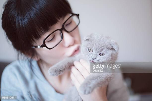 Woman kiss a kitten