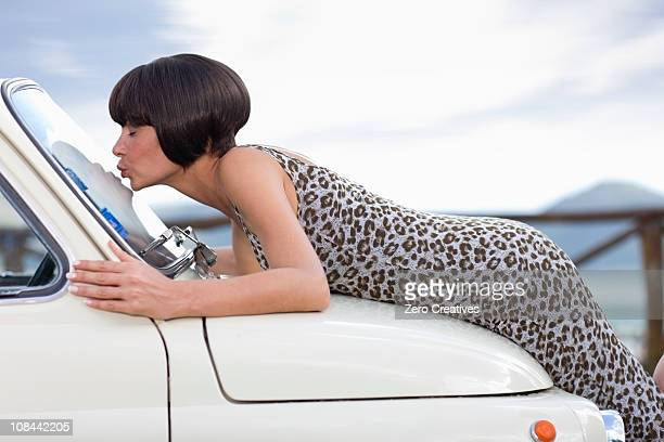 Woman kissing a car