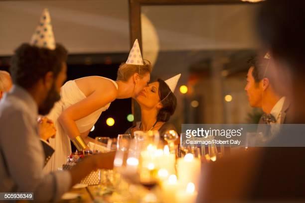 Woman kissing friend?s cheek at birthday party