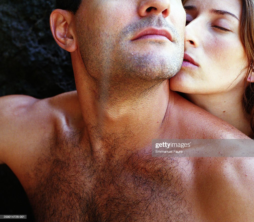 Woman kissing man, close up : Stock Photo