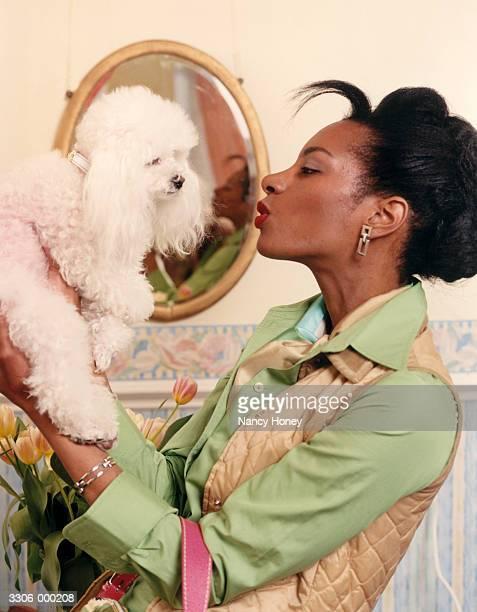 Woman Kissing Poodle