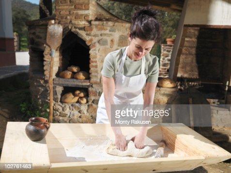 Woman kneading bread dough