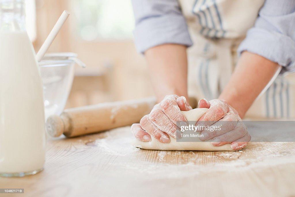 Woman kneading dough on kitchen counter : Stock Photo