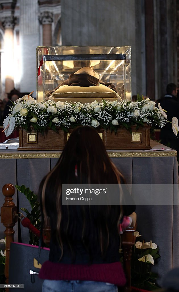 A woman kneels before the corpse and relics of Padre Pio on display in St. Peter's Basilica for veneration by the faithful in connection with the ongoing Extraordinary Jubilee Year of Mercy on February 6, 2016 in Vatican City, Vatican. St. Pius of Pietralcina or San Padre Pio, as he is popularly known around the world was a Capuchin friar with a worldwide reputation during his earthly life as a mystic and miracle-worker, who was also a tireless confessor and laborer in favor of the poor, the sick, and the downtrodden.