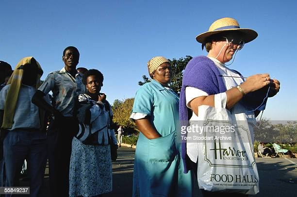 A woman knits in the queue to vote on the day that freedom came to South Africa when Nelson Mandela was elected as President
