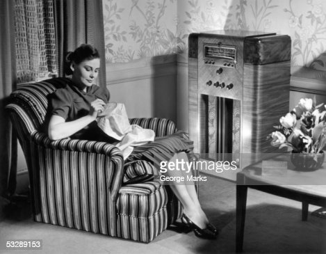 Woman knitting and listening to the radi : Stock Photo