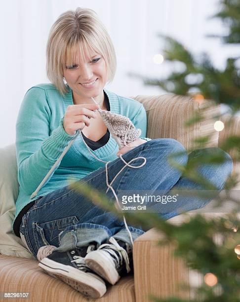 Woman knitting at Christmas